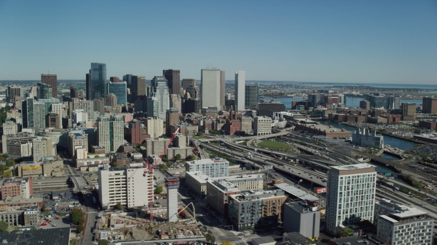 6K stock footage aerial video flying by skyscrapers, revealing Interstate 93, Downtown Boston, Massachusetts Aerial Stock Footage | AX142_204
