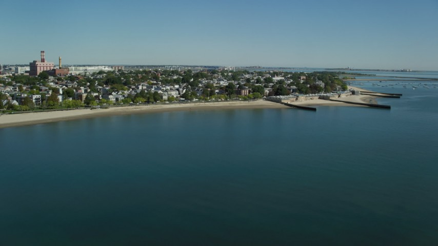 6K stock footage aerial video flying by coastal community, South Boston, Massachusetts Aerial Stock Footage | AX142_208