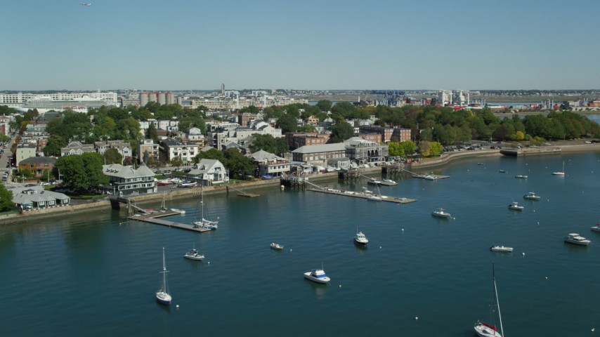 6K stock footage aerial video flying by piers, anchored boats, South Boston, Massachusetts Aerial Stock Footage | AX142_213