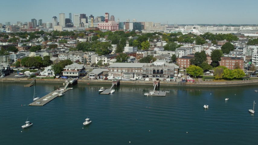 6K stock footage aerial video flying by piers, anchored boats, South Boston, Massachusetts Aerial Stock Footage | AX142_214