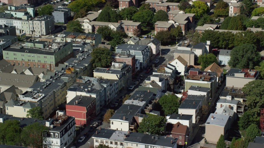 6K stock footage aerial video flying by row houses, streets, South Boston, Massachusetts Aerial Stock Footage | AX142_229