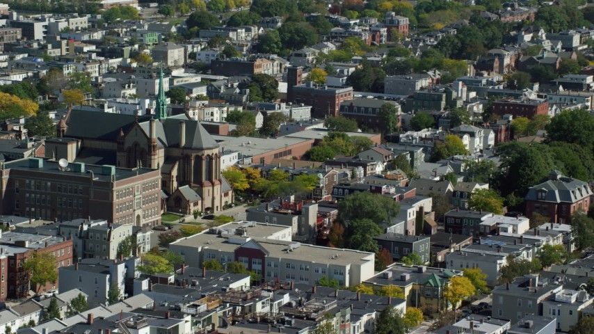 6K stock footage aerial video flying by the Gate of Heaven Catholic Church, South Boston, Massachusetts Aerial Stock Footage | AX142_231