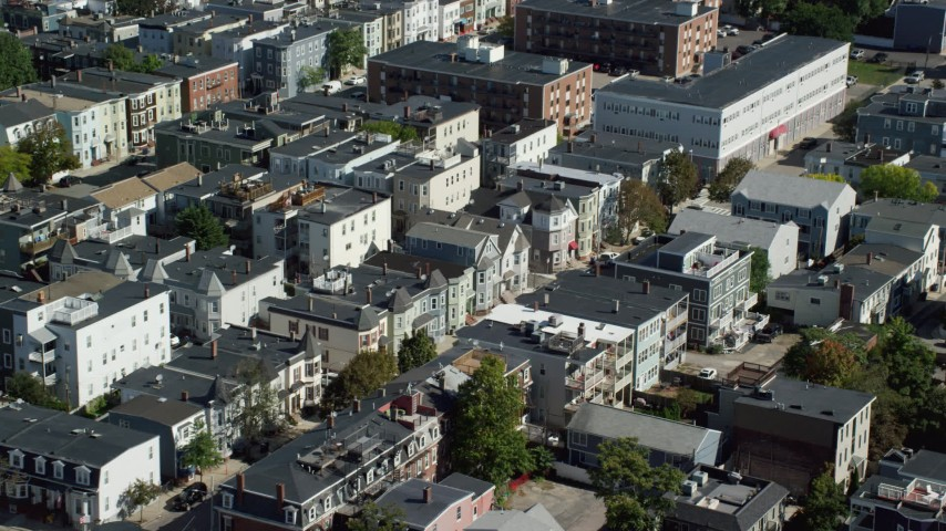 6K stock footage aerial video flying by residential neighborhoods, tilt down, South Boston, Massachusetts Aerial Stock Footage | AX142_233