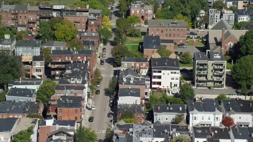 6K stock footage aerial video flying by apartment buildings, quiet streets, South Boston, Massachusetts Aerial Stock Footage | AX142_234