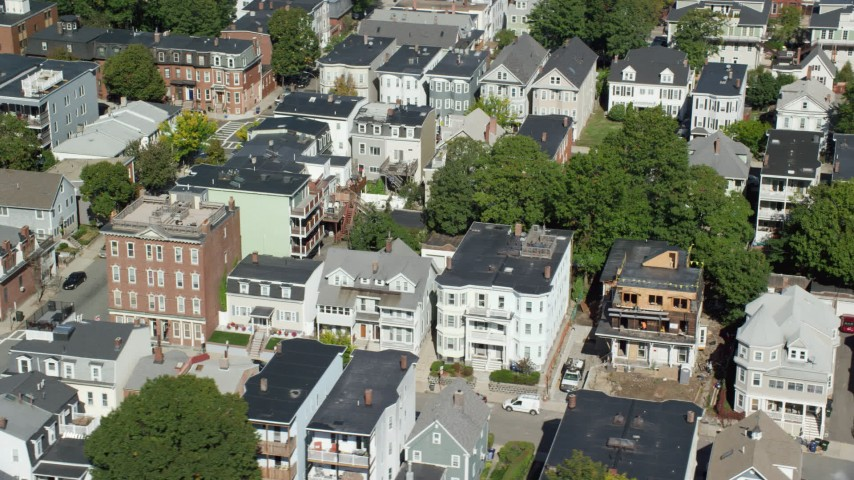 6K stock footage aerial video flying by apartment buildings, quiet streets, South Boston, Massachusetts Aerial Stock Footage | AX142_235
