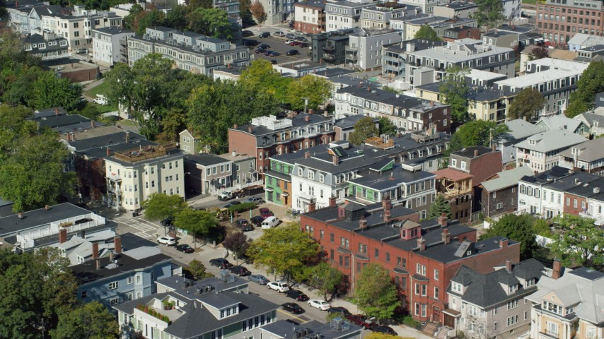 6K stock footage aerial video flying by row houses, tilt down, South Boston, Massachusetts Aerial Stock Footage | AX142_236