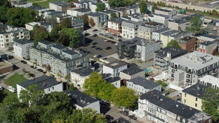 Flying By Apartment Buildings, Tilt Down, South Boston, Massachusetts  Aerial Stock Footage AX142_237