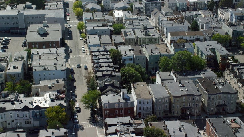6K stock footage aerial video flying by row houses, apartment buildings, South Boston, Massachusetts Aerial Stock Footage | AX142_238
