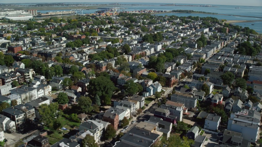 6K stock footage aerial video flying by coastal communities, tilt down, South Boston, Massachusetts Aerial Stock Footage | AX142_243