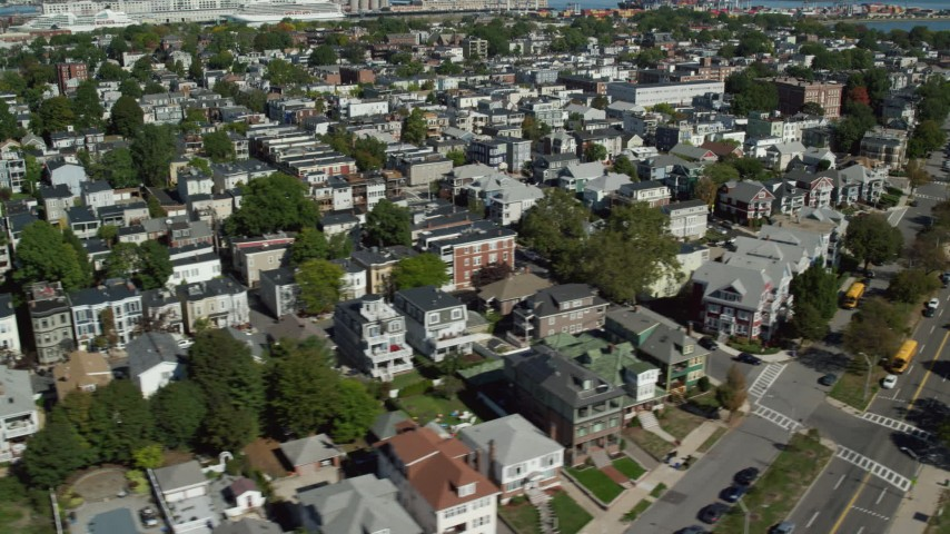 6K stock footage aerial video flying by a coastal community, reveal beach, South Boston, Massachusetts Aerial Stock Footage | AX142_244
