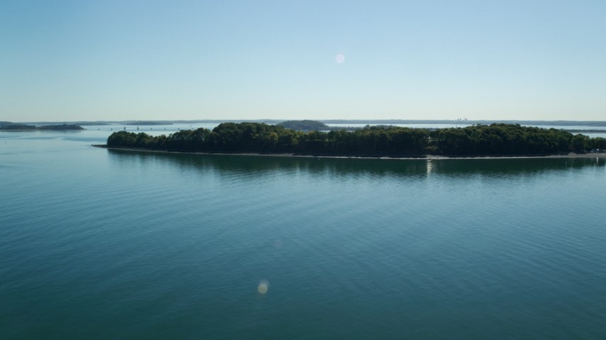 6K stock footage aerial video flying by Thompson Island, Boston Harbor, Massachusetts Aerial Stock Footage | AX142_247