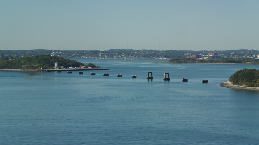 6K stock footage aerial video flying by unfinished bridge, Moon Island, Boston Harbor, Massachusetts Aerial Stock Footage   AX142_281