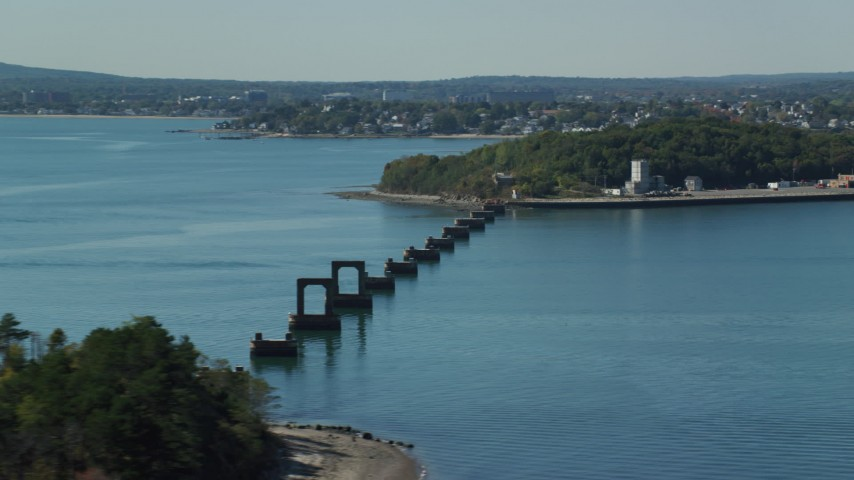 6K stock footage aerial video flying by unfinished bridge, Moon Island, Boston Harbor, Massachusetts Aerial Stock Footage | AX142_282
