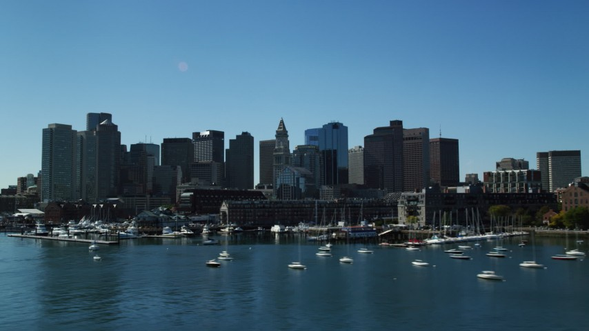 6K stock footage aerial video flying by wharves, waterfront property, skyline, Downtown Boston, Massachusetts Aerial Stock Footage   AX142_296