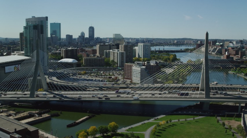 6K stock footage aerial video flying by the Zakim Bridge and TD Garden, Boston, Massachusetts Aerial Stock Footage AX142_300 | Axiom Images