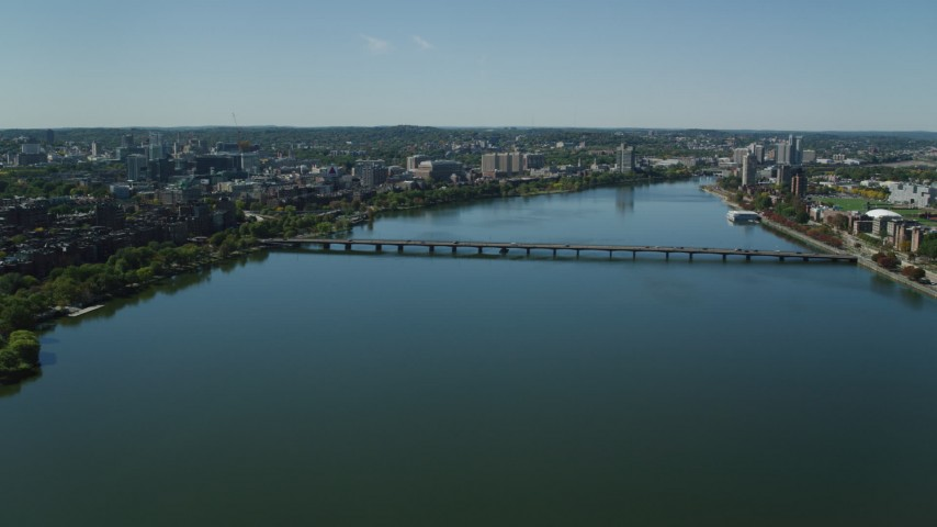 6K stock footage aerial video flying over Charles River, by the Harvard Bridge, Boston, Massachusetts Aerial Stock Footage | AX142_305