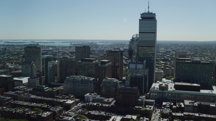 6K stock footage aerial video flying by Prudential Tower, buildings, Downtown Boston, Massachusetts Aerial Stock Footage | AX142_306