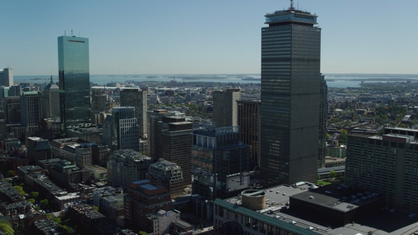 6K stock footage aerial video flying by John Hancock Tower, Prudential Tower, Downtown Boston, Massachusetts Aerial Stock Footage   AX142_307