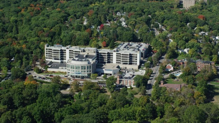 6K stock footage aerial video flying by Faulkner Hospital, colorful trees,  autumn, Jamaica Plain, Massachusetts