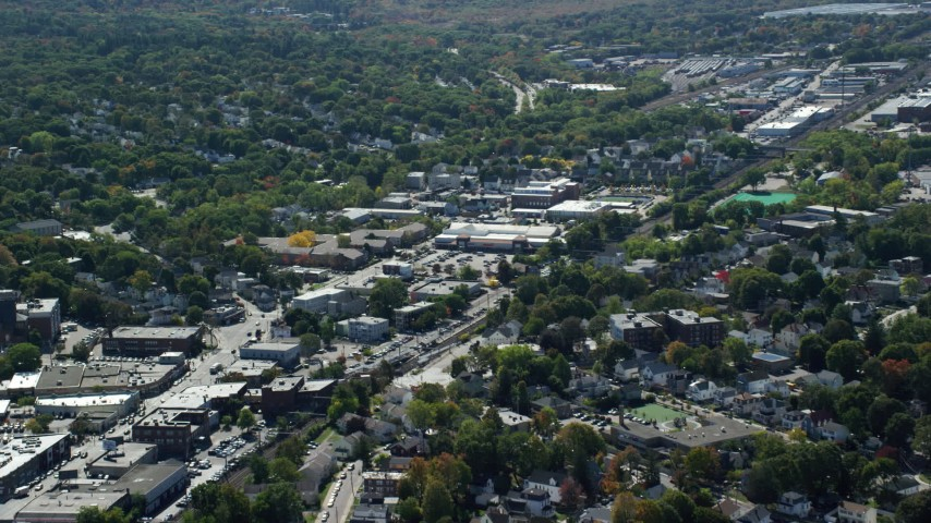6K stock footage aerial video flying by large strip mall, neighborhoods, Hyde Park, Massachusetts Aerial Stock Footage | AX142_317