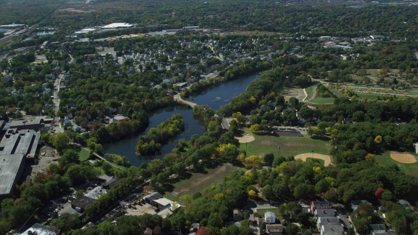 6K stock footage aerial video flying over small town neighborhoods, approach Mill Pond, Hyde Park, Massachusetts Aerial Stock Footage | AX142_319