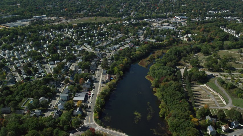 6K stock footage aerial video flying over small town neighborhoods, Mill Pond, Hyde Park, Massachusetts Aerial Stock Footage | AX142_320