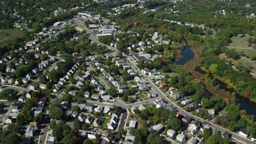 6K stock footage aerial video flying by small town neighborhoods, Mill Pond, Hyde Park, Massachusetts Aerial Stock Footage | AX142_321