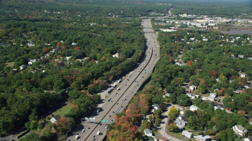 6K stock footage aerial video flying over neighborhoods, Interstate 93, autumn, Westwood, Massachusetts Aerial Stock Footage | AX142_323