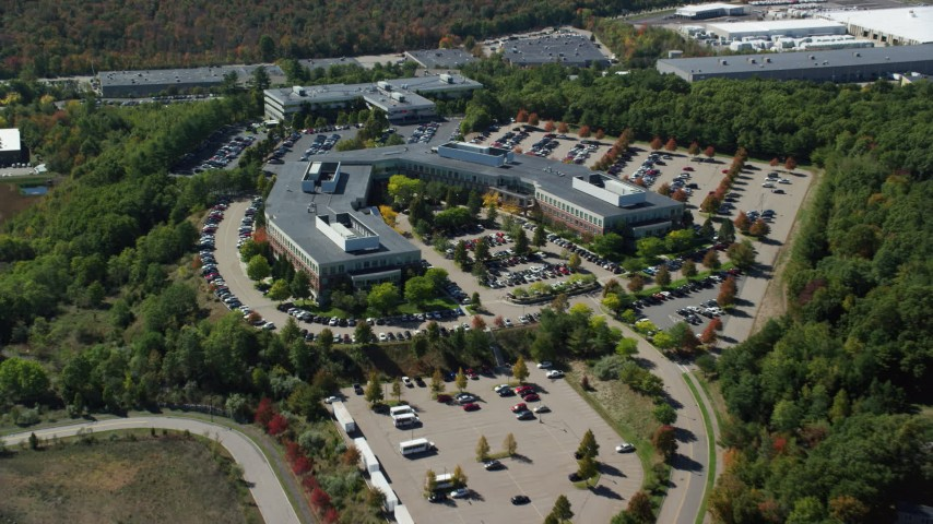 6K stock footage aerial video approaching, flying over office building, tilt down, autumn, Westwood, Massachusetts Aerial Stock Footage | AX142_324