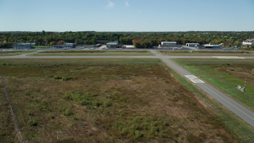 6K stock footage aerial video approaching the airport, autumn, Norwood Memorial Airport, Massachusetts Aerial Stock Footage | AX142_327