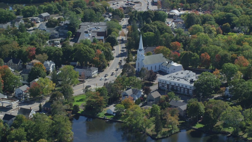6K stock footage aerial video flying by South Congregational Church, small town, autumn, Braintree, Massachusetts Aerial Stock Footage AX143_009 | Axiom Images