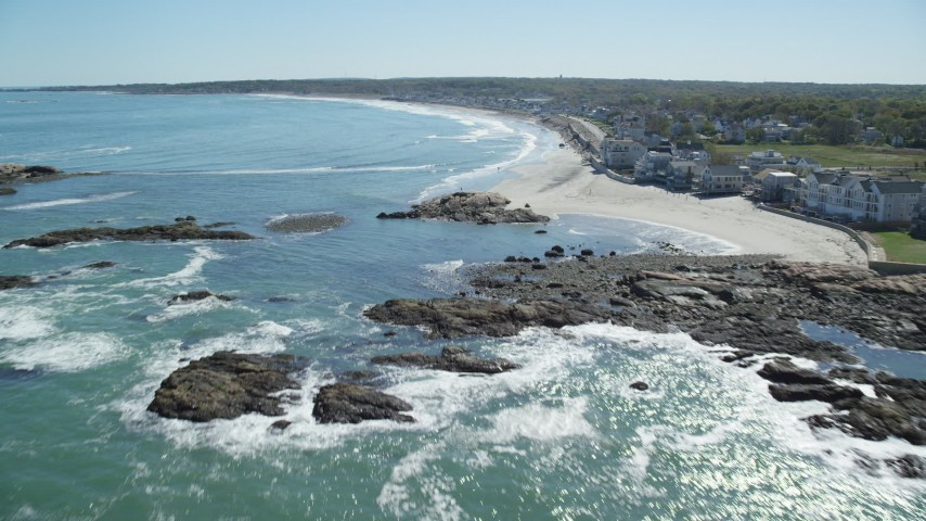 6K stock footage aerial video flying by beach, upscale oceanfront homes, Scituate, Massachusetts Aerial Stock Footage | AX143_031