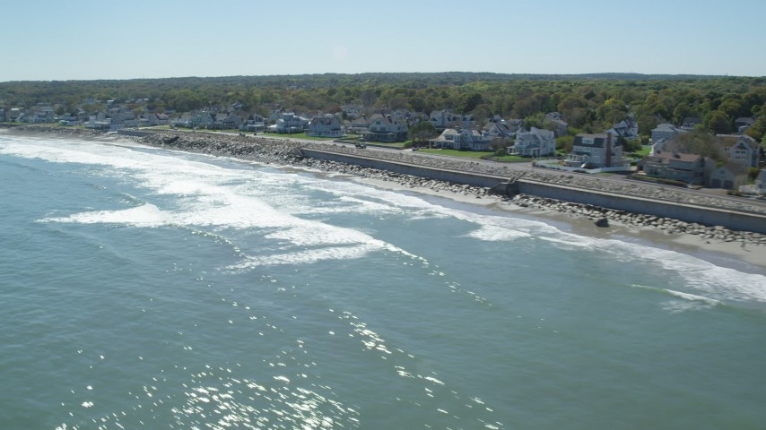 Flying by beach, upscale oceanfront homes, Scituate, Massachusetts Aerial Stock Footage | AX143_032
