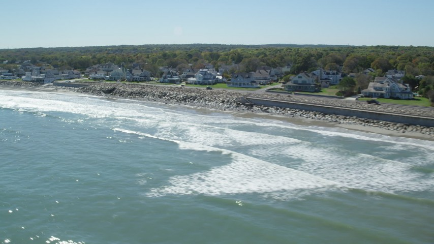 6K stock footage aerial video flying by beach, upscale oceanfront homes, Scituate, Massachusetts Aerial Stock Footage | AX143_032