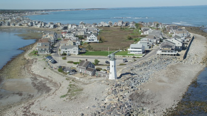 6K stock footage aerial video orbiting a beach, oceanfront homes, Old Scituate Light, Scituate, Massachusetts Aerial Stock Footage | AX143_041