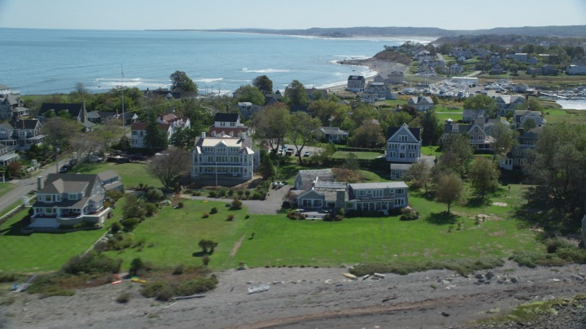 6K stock footage aerial video flying by rocky beach, oceanfront homes, Scituate, Massachusetts Aerial Stock Footage | AX143_042