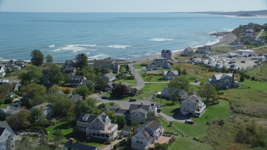6K stock footage aerial video flying by beach, oceanfront homes, Scituate, Massachusetts Aerial Stock Footage | AX143_043