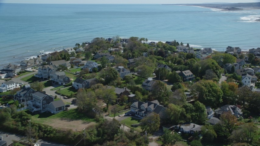 6K stock footage aerial video flying by upscale oceanfront homes, Scituate, Massachusetts Aerial Stock Footage | AX143_044