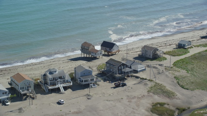 6K aerial video flying by elevated oceanfront homes, Scituate, Massachusetts Aerial Stock Footage | AX143_045