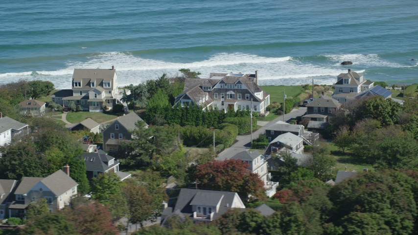 6K stock footage aerial video flying by upscale oceanfront homes, Scituate, Massachusetts Aerial Stock Footage | AX143_046