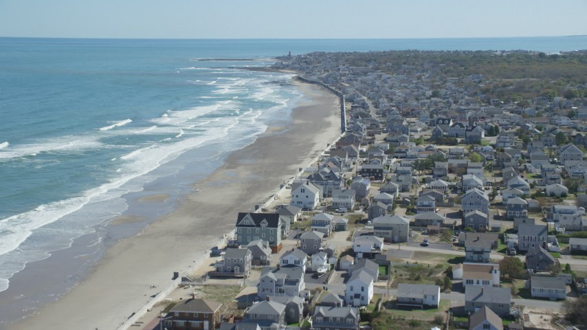 6K aerial video flying over oceanfront homes, approaching coastal town, Marshfield, Massachusetts Aerial Stock Footage | AX143_056
