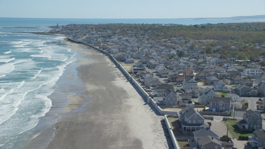 6K aerial video flying over beach,  oceanfront homes, small coastal town, Marshfield, Massachusetts Aerial Stock Footage AX143_057