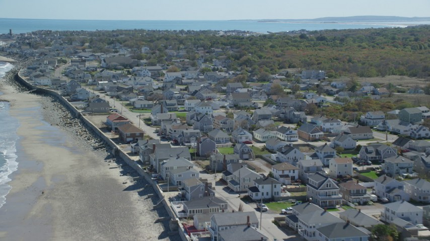 Flying over oceanfront homes, small coastal town, Marshfield, Massachusetts Aerial Stock Footage | AX143_058