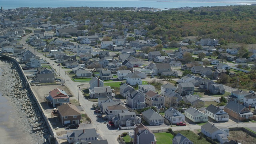 6K aerial video flying over oceanfront homes, small coastal town, Marshfield, Massachusetts Aerial Stock Footage | AX143_058