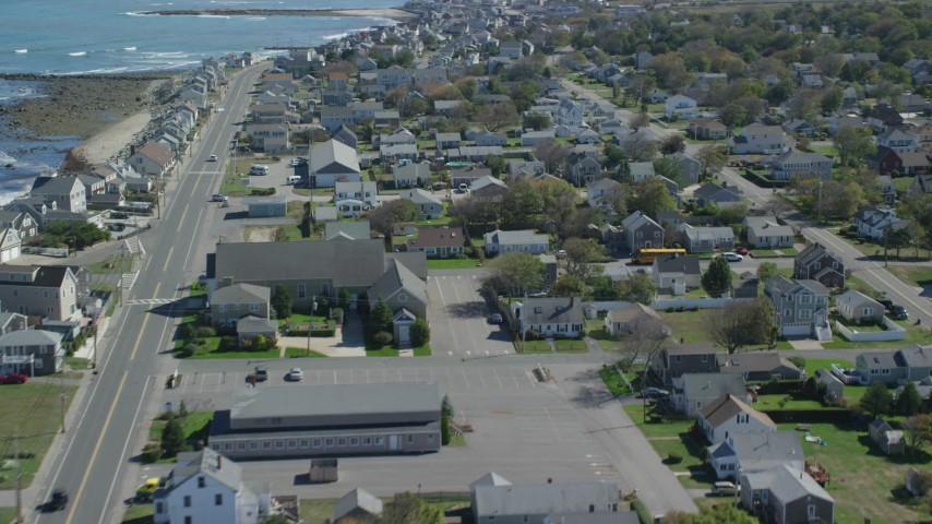 6K aerial video flying by oceanfront homes, small coastal town, Marshfield, Massachusetts Aerial Stock Footage | AX143_059