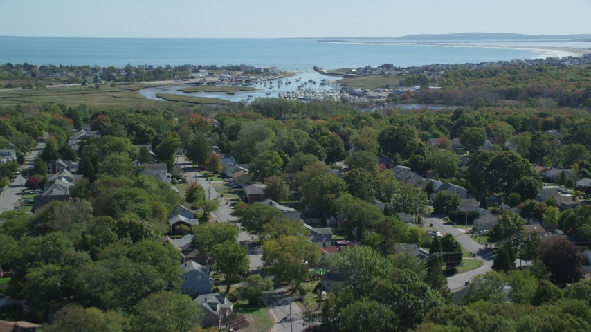 Fly over small town, approaching marina, autumn, Marshfield, Massachusetts Aerial Stock Footage | AX143_060