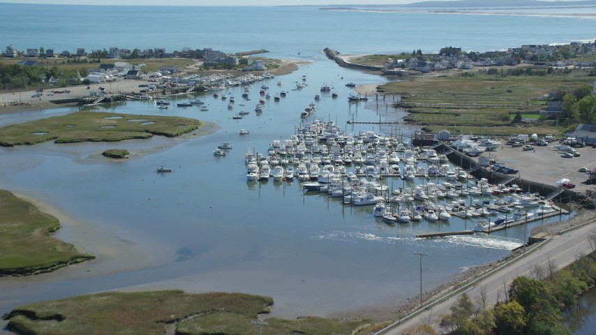 6K aerial video flying over a small marina, fighting boats, Marshfield, Massachusetts Aerial Stock Footage | AX143_061