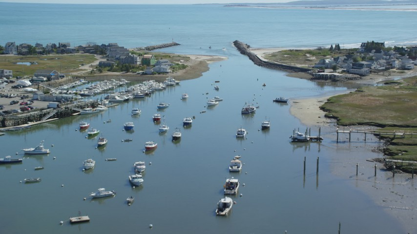 Fishing boats, small town, approaching Cape Cod Bay, Marshfield, Massachusetts Aerial Stock Footage | AX143_062