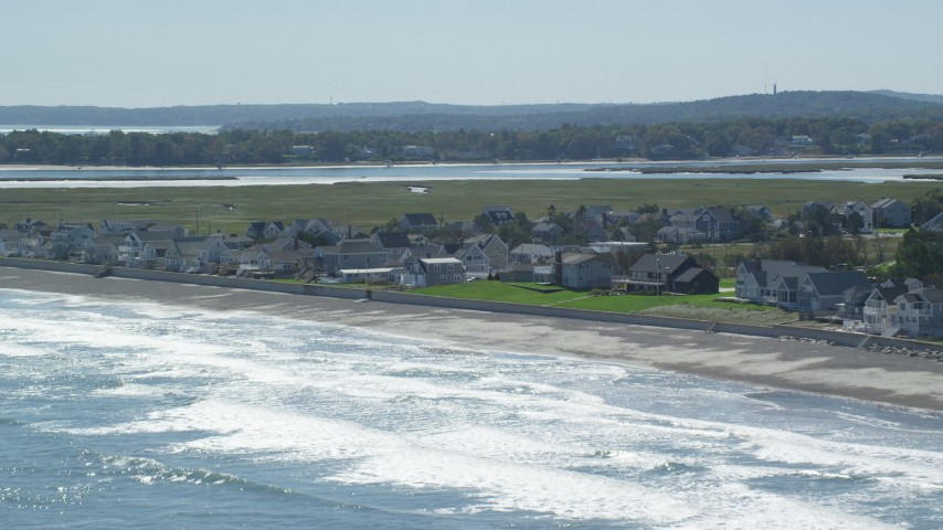6K stock footage aerial video approaching beachfront homes, rolling waves, beach, Duxbury, Massachusetts Aerial Stock Footage | AX143_064