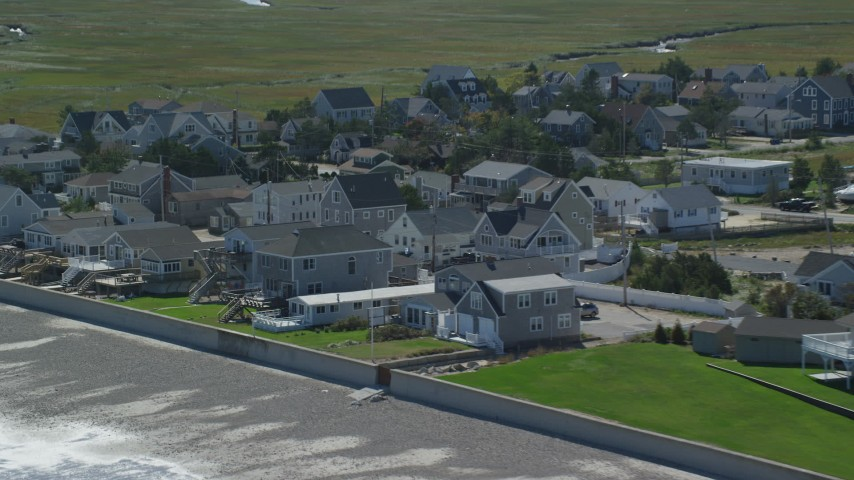 6K stock footage aerial video approaching beachfront homes, tilting down, Duxbury, Massachusetts Aerial Stock Footage | AX143_065